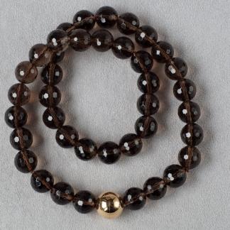 Halskette aus Rauchquarzkugeln mit einem 750/-Gold Magnetverschluss