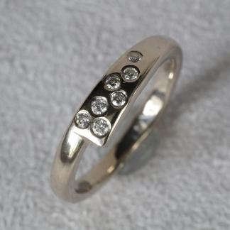 Vorsteckring aus 585/- Weißgold mit 7 Brillanten die aus einem alten Ring stammen