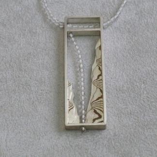 Mokume Gane Kettenanhänger mit Bergkristall aus 925/- Silber und Kupfer